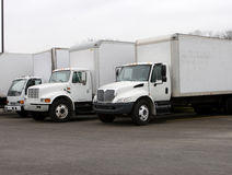 Delivery Trucks. White Delivery Trucks Royalty Free Stock Photo