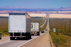 Delivery trucks highway Royalty Free Stock Image