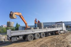 Delivery and unloading of construction materials royalty free stock images
