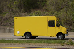 Delivery Van. Yellow Delivery Van on the Highway Royalty Free Stock Photography