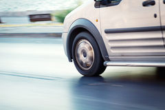 Delivery Van. Close up speedy blurred motion image Royalty Free Stock Photography
