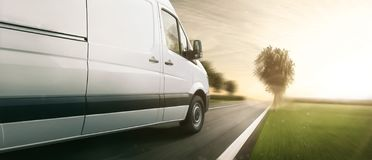 Free Delivery Van Drives On A Highway Royalty Free Stock Image - 135399516