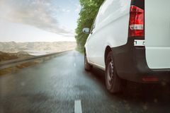 Delivery van driving through nature royalty free stock photography