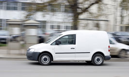 Delivery van. In high speed driving on street Royalty Free Stock Images
