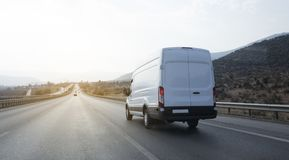 Delivery Van. On highway blurred motion Stock Photos