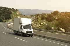 Delivery Van. White delivery van on the highway royalty free stock photography