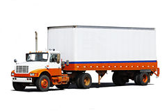 Delivery Vehicle. A delivery vehicle with lots of space for your text on trailer Stock Photos
