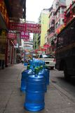 Delivery of Water Bottles on the Street. Water Delivery on the foot path in Hong Kong Stock Image