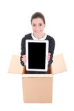 Delivery - woman in cardboard box holding tablet pc with blank s Stock Image