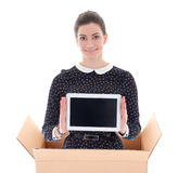 Delivery - woman in cardboard box holding tablet pc isolated on Stock Images