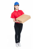 Delivery woman carrying cardboard box Royalty Free Stock Images