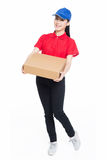 Delivery woman carrying cardboard box Stock Photography