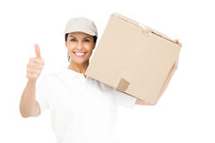 Delivery woman carrying a package and showing thumbs up Royalty Free Stock Image