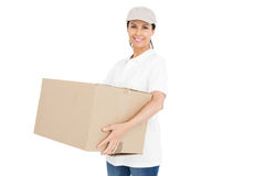 Delivery woman carrying a package Royalty Free Stock Image