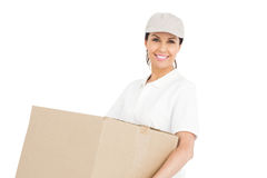 Delivery woman carrying a package Stock Photo