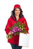 Delivery woman with flowers Royalty Free Stock Images