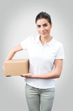 Delivery woman holding a box Royalty Free Stock Photo