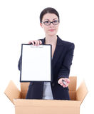 Delivery - woman holding clipboard with copyspace in cardboard b Royalty Free Stock Images