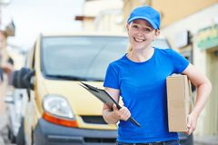 Delivery woman with package outdoors Royalty Free Stock Photos