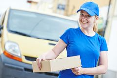 Delivery woman with package outdoors Stock Images