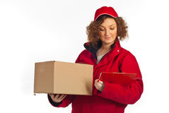 Delivery woman reading clipboard Stock Photography