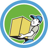 Delivery Worker Carrying Package Cartoon. Illustration of a delivery worker delivering carrying parcel package carton box set inside circle on isolated Royalty Free Stock Images