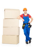 Delivery worker man with paper boxes Stock Image