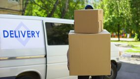 Delivery workman holding many cardboard boxes, express parcel shipment service. Stock footage stock footage