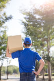 Deliveryman back to you Stock Image