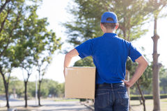 Deliveryman back to you Stock Photo
