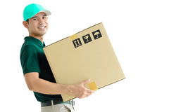 Deliveryman carrying a cardboard box Stock Image