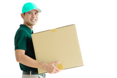 Deliveryman carrying a cardboard box Royalty Free Stock Photo
