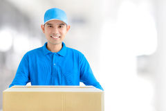 Deliveryman carrying a cardboard parcel box Royalty Free Stock Photo