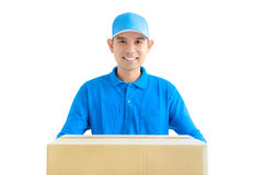 Deliveryman carrying a cardboard parcel box Royalty Free Stock Photos