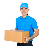 Deliveryman carrying a cardboard parcel box Stock Images