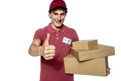 Deliveryman carrying a parcel box, giving thumbs up Stock Image
