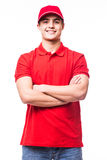 Deliveryman with crossed arms Stock Images