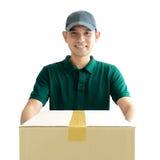 Deliveryman giving a cardboard parcel box Stock Photos
