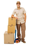 Deliveryman Leaning On Stacked Cardboard Boxes Stock Photos