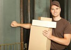 Deliveryman ocupado imagen de archivo