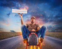 Free Deliveryman Runs Fast With A Toy Car To Deliver Pizza Stock Photography - 217837662