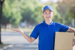 Deliveryman show something Royalty Free Stock Photo