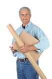 Deliveryman sorridente con i pacchetti Fotografie Stock