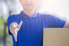 Deliveryman stand and shake hand Stock Photos