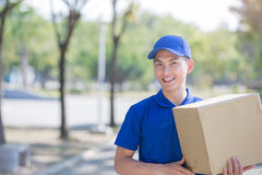 Deliveryman stand and smile Royalty Free Stock Images
