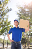 Deliveryman stand and smile Stock Image