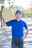 Deliveryman stand and smile Stock Photos