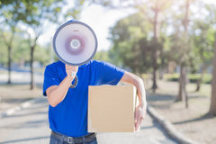 Deliveryman take megaphone Royalty Free Stock Photography