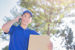 Deliveryman talk on phone Royalty Free Stock Image