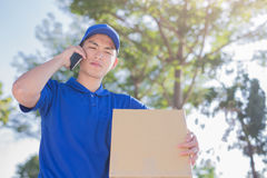 Deliveryman talk on phone Stock Photography